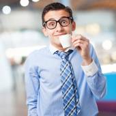 Businessman with coffee cup — Stock Photo