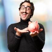 Pedantic man with a piggy bank — Stock Photo