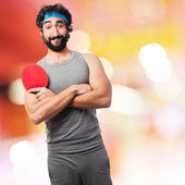 Sportsman playing ping pong — Stock Photo