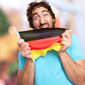 Crazy man with flag — Stock Photo