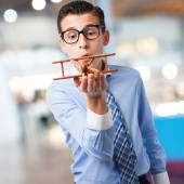 Businessman with wooden plane — Stock Photo