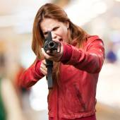 Blond woman with a gun — Stock Photo