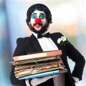 Clown with archives — Stock Photo