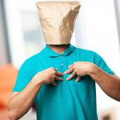 Proud man with a paper bag in his head — Stock Photo