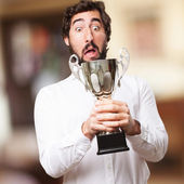 Man with a champion cup — Stockfoto