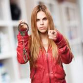 Blond woman with handcuffs — Stock Photo