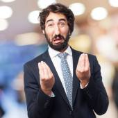 Confused businessman sign — Stock Photo
