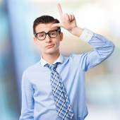 Businessman loser gesture — Stock Photo