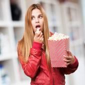 Blond woman with pop corns — Stock Photo