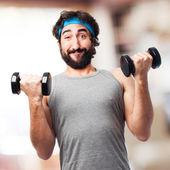 Sportman with dumbbells — Stock Photo