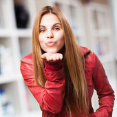 Woman sending a kiss — Stock Photo