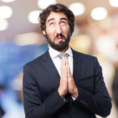 Businessman praying — Stock Photo