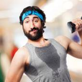 Sportsman with dumbbells — Stock Photo