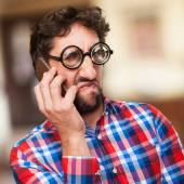 Crazy angry man speaking on phone — Stock Photo
