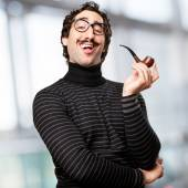 Pedantic man with a pipe — Stock Photo
