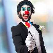 Clown with a lolly pop — Stock Photo