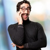 Pedantic man speaking on phone — Stock Photo
