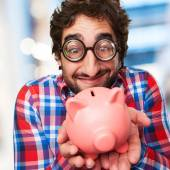 Crazy man with a piggy bank — Stock Photo