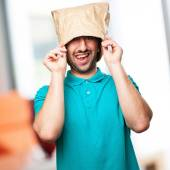 Happy man with  paper bag in his head — Stock Photo