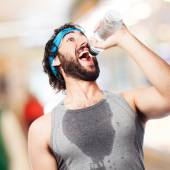 Sportsman drinking water — Stock Photo