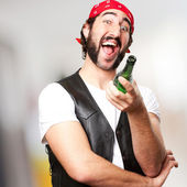 Motorcyclist man drinking — Stock Photo