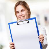 Blond woman with paper and pen — Foto de Stock