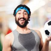 Sportsman with football ball — Stock Photo