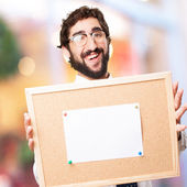Businessman with cork board — Stock Photo