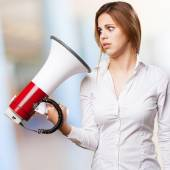 Blond woman with a megaphone — Stock Photo