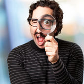 Pedantic man with a magnifier surprised — Stock Photo