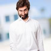Angry man smoking — Stock Photo