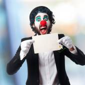 Clown with a banner — Stock Photo