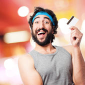 Sportsman with credit card — Stock Photo