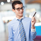 Young boy with a credit card — Stock Photo