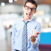 Businessman with a dice — Stock Photo