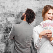 Blond woman with money — Stock Photo #73374041