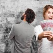 Blond woman with money — Stock Photo #73374131