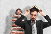 Young crazy businessman boring with a book — Stock Photo