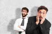 Young crazy businessman scared pose — Stock Photo
