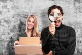 Pedantic man with a magnifier — Stock Photo
