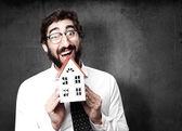 Empresario con una casa — Foto de Stock