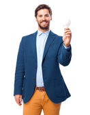 Angry businessman with light bulb — Stock Photo