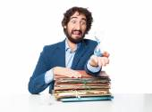 Businessman with files and sand timer — Stock Photo