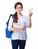 Chinese woman victory sign with notebook — Stock Photo