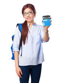 Chinese woman thinking with calculator — Stock Photo