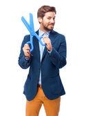 Happy businessman with scissors — Stock Photo