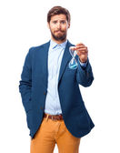 Worried businessman with sand timer — Stock Photo