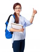 Chinese woman okay sign with notebook — Stock Photo