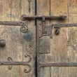 Old wooden gate with an ancient metal lock, Villefranche de Conflent, France. — Stock Photo #61000901