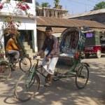 Постер, плакат: Rickshaws drive by the street in Bandarban Bangladesh